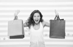 Feel free buy everything you want. Woman carries bunch shopping bags striped background. Finally bought favorite brand. Tips shop sales. Girl satisfied with stock photography