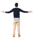 Feel free. Rear view of Asian young man open arms and feel free, full length portrait stock photo