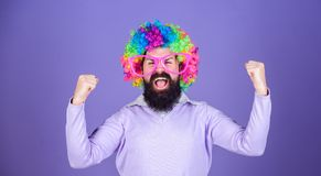 Feel free to express yourself. Having fun. Holiday fun and carnival concept. Man bearded wear colorful wig and funny. Glasses on violet background. Clown and royalty free stock image