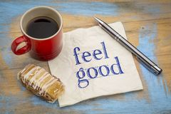 Feel good note on napkin. Feel good - handwriting on a napkin with a cup of coffee and cookie stock photos