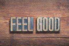 Feel good wood. Feel good phrase combined on vintage varnished wooden surface royalty free stock photo