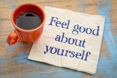Feel good about yourself. Motivational advice - handwriting on a napkin with a cup of espresso coffee stock photo