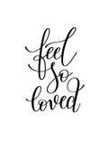 Feel so loved black and white hand written lettering romantic qu Stock Image