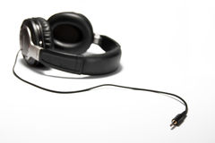 Feel the music. A headphone isolated with a white background Stock Images