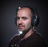 Feel the music. Portrait of young confident man wearing headphone Stock Photo