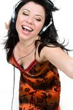 Feel the music. A spirited girl dances to music Royalty Free Stock Images