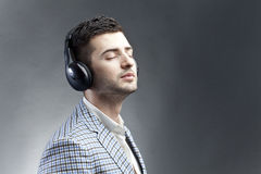 Feel the music. Young man with headphones listening and feeling the sound of the music Royalty Free Stock Photos