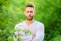 Feel power of nature. Man handsome bearded hipster stand confidently nature background. Skin care. Nature peaceful royalty free stock photography