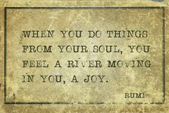 Feel a river Rumi. When you do things from your soul, you feel a river moving in you, a joy - ancient Persian poet and philosopher Rumi quote printed on grunge royalty free stock photos