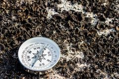 Feel safe with a reliable compass. Don`t lose your direction. Concept for travelling and active lifestyle royalty free stock photos