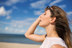 Feel the sea breeze on her face Stock Photography