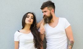 Feel their style. Couple white shirts cuddle each other. Hipster bearded and stylish girl hang out urban romantic date. Couple friends hang out together grey royalty free stock images