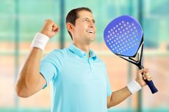 The feel of victory. Portrait of a young male paddle tennis player celebrating a victory at sports facilities Stock Image