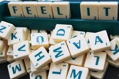 Feel It. A word written on a scrabble board Stock Images