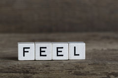 Feel, written in cubes Stock Images