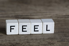 Feel, written in cubes Royalty Free Stock Photography