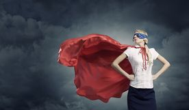 Feel yourself a hero!. Young confident woman in super hero costume stock images