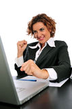 A Feeling of Accomplishment. A business woman sitting at her desk, who has just completed her work on the computer and feels accomplished Stock Images