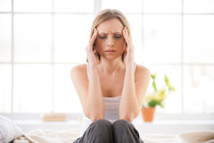 Feeling awful headache. Stock Photography