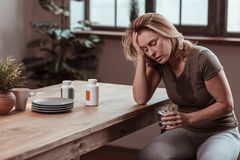 Stressed woman sweating and feeling awful after panic attack. Feeling awful. Stressed and depressed woman sweating and feeling awful after panic attack royalty free stock photography