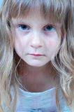 Feeling bad. Portrait of a little upset girl looking sick Royalty Free Stock Image