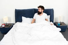 Feeling calm. energy and tiredness. asleep and awake. bearded man hipster sleep in morning. brutal sleepy man in bedroom. Mature male with beard in pajama on stock images
