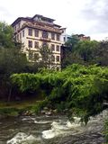 Historic Landmark Building on the Tomebamba River in Cuenca Ecuador. A feeling of classic old world charm as one looks at this landmark building overlooking the stock photography
