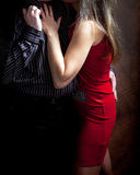 Feeling of closeness and love, affection, tenderness 2. Feeling of closeness and love, affection, tenderness, young woman, red dress, man holding her tenderly Stock Photography