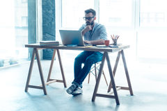 Feeling comfortable at his working place. Royalty Free Stock Photography