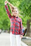 Feeling cozy and comfortable on windy day. Deal with long hair on windy day. Hairstyles to wear on windy days. Windproof. Hairstyles. Girl little cute child stock photography
