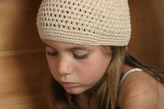 Feeling down. Young girl with sad look on face Stock Image