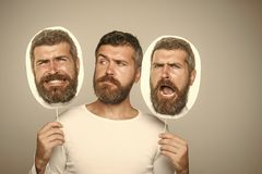Feeling and emotions. Man with long beard and mustache. Barber fashion and beauty. Guy or bearded man on grey background. Hipster with sad face hold portrait royalty free stock photos