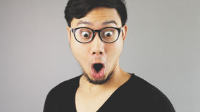 Feeling excite with something. An asian man with black t-shirt Stock Image