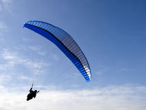 Feeling free. A man with a para-glider high in the air Royalty Free Stock Image