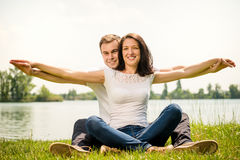 Feeling free - young happy couple Stock Photography