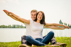 Feeling free - young happy couple Stock Images