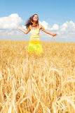 Feeling the freedom. Beautiful girl in a wheat field Royalty Free Stock Photos