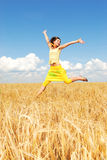 Feeling the freedom. Beautiful girl in a wheat field Stock Images