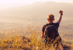 Feeling freedom mountain climber greeting sun Royalty Free Stock Photos