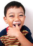 Feeling good. Young asian boy very happy royalty free stock image