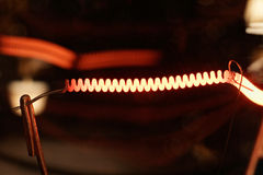 Light Bulb. The glowing filament of a light bulb Stock Photography