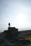 Feeling invincible. Man standing on top of a hill overlooking the world at Hookney, UK Stock Photo