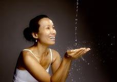 Feeling the joy of splashing water. Royalty Free Stock Image
