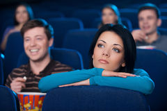 Feeling lonely at the cinema. Stock Photography