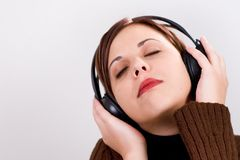 Feeling the music. Girl with headphones enjoying music Stock Photos