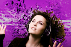 Feeling the music. Fresh modern woman listening to music Stock Photo