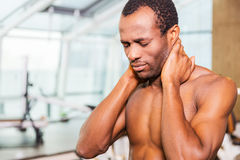Feeling neckache after workout. Royalty Free Stock Photos