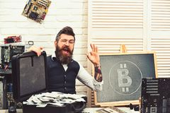 Feeling okay. From paper money to crypto currency. Bearded man with cash money. Business man in server room. Bearded royalty free stock image