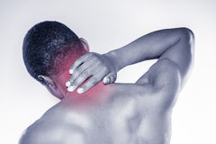 Feeling pain in his neck. Stock Image