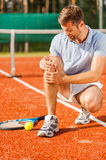 Feeling pain in knee. Royalty Free Stock Images